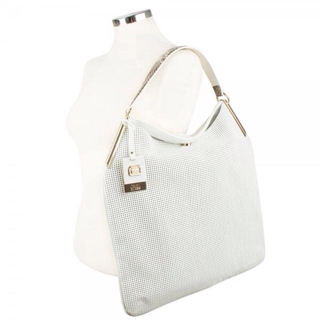 Женская сумка выполнена из высококачественной перфорированной кожи. Удобная вместительная модель, представлена в 2-х цветах бирюзовый, светло-кофейный. Фото 1