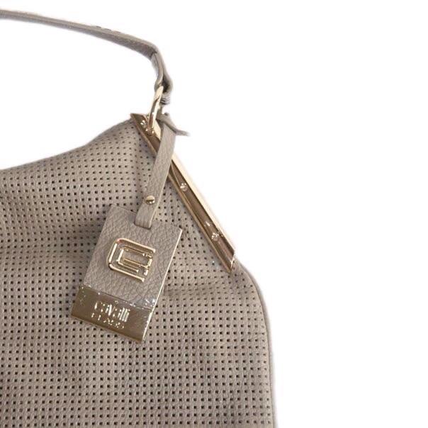 Женская сумка выполнена из высококачественной перфорированной кожи. Удобная вместительная модель, представлена в 2-х цветах бирюзовый, светло-кофейный. Фото 4