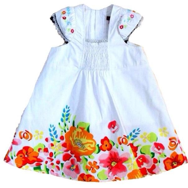 Фото 1: Белое детское платье снизу цветочек