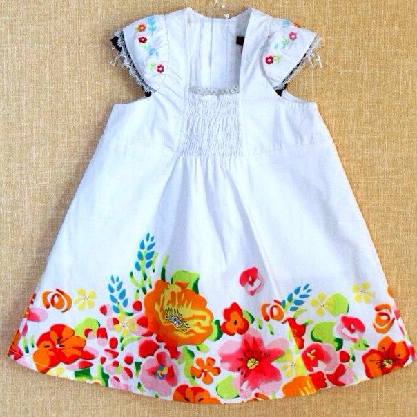 Фото 2: Белое детское платье снизу цветочек