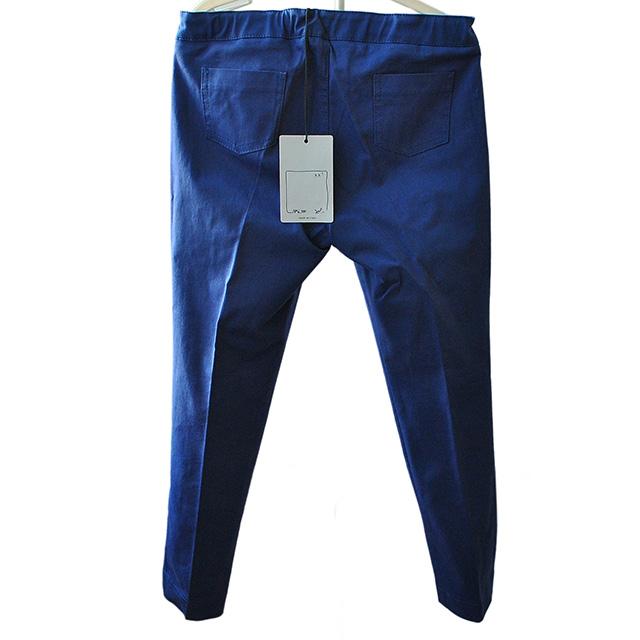 Классические синие брюки. На поясе бант, зауженные к низу. Фото: 2