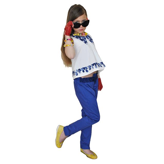 Классические синие брюки. На поясе бант, зауженные к низу. Фото: 4