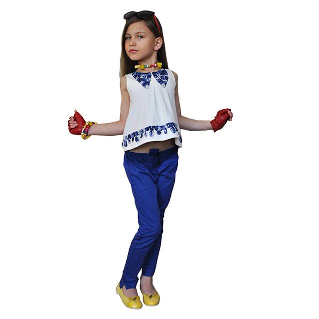 Классические синие брюки. На поясе бант, зауженные к низу. Фото: 6